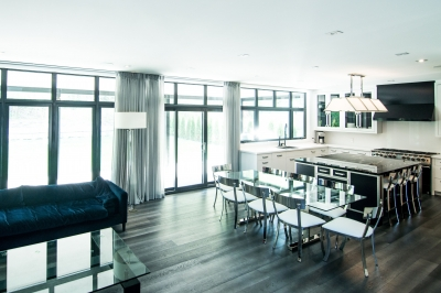 Designs by Santy :: Escarpment Modern Great room, dining and kitchen areas with ceiling-high windows