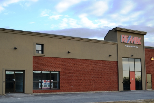 Designs by Santy :: Remax Reno Store front elevation with brick and stucco