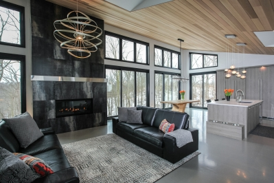 Designs by Santy :: Bridge House Great room with fireplace and high windows