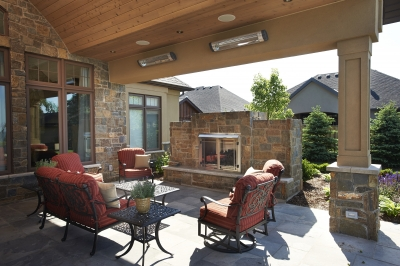 Designs by Santy :: Lakefront Paradise Back porch with outdoor fireplace