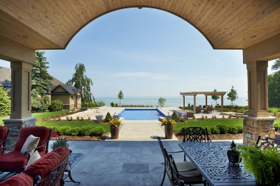 Designs by Santy :: Lakefront Paradise Back porch view with arched ceiling and matching shed