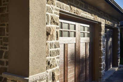Designs by Santy :: Royal Revival Wood panel garage with stone and stucco