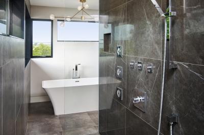 Designs by Santy :: Modern Prairie ensuite with walk-through shower and free-standing bathtub
