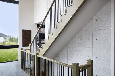 Designs by Santy :: Modern Prairie staircase with large window, wood concrete finish