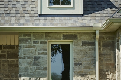 Designs by Santy :: French Country Revival Front exterior with curved dormer and stone