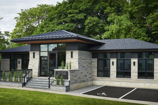 Designs by Santy :: Ravine Office Front exterior with prairie roof and tapered buttresses