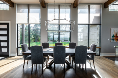 Designs by Santy :: Modern Lakehouse Dining room with modern window grills, transom and wood beams