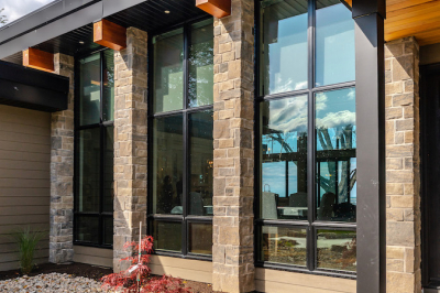Designs by Santy :: Modern Lakehouse Front exterior with stone, wood beams and modern window grills
