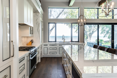 Designs by Santy :: Modern Lakehouse Kitchen with island, marble counter, large windows and lake view