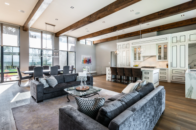 Designs by Santy :: Modern Lakehouse Open concept great room view to kitchen and dining with wood beams and window grills