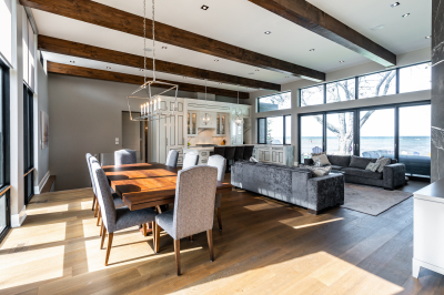 Designs by Santy :: Modern Lakehouse Open concept dining area view to kitchen and great room with wood beams and lake view