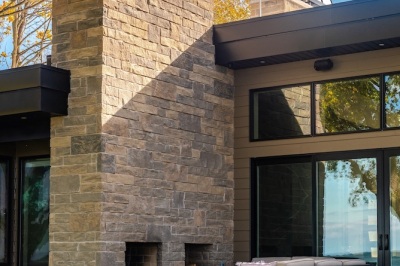 Designs by Santy :: Modern Lakehouse Rear exterior with patio and outdoor fireplace