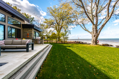 Designs by Santy :: Modern Lakehouse Rear exterior with patio and lake view