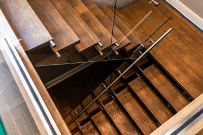 Designs by Santy :: Modern Lakehouse Wood staircase with glass railing