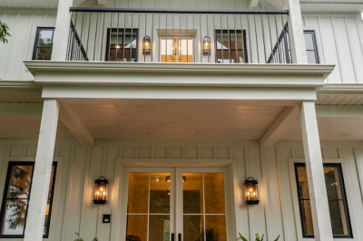 Designs by Santy :: Coastal Farmhouse Grand entry with double doors, sconces balcony and white stained lumber