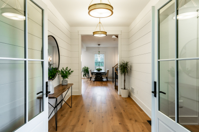 Designs by Santy :: Coastal Farmhouse Grand entry double doors with view to foyer and dining area