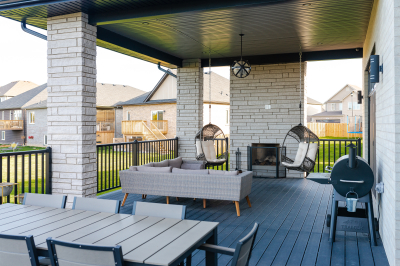 Designs by Santy :: Modern Pilaster Home Covered deck with rectangular stone columns and outdoor fireplace