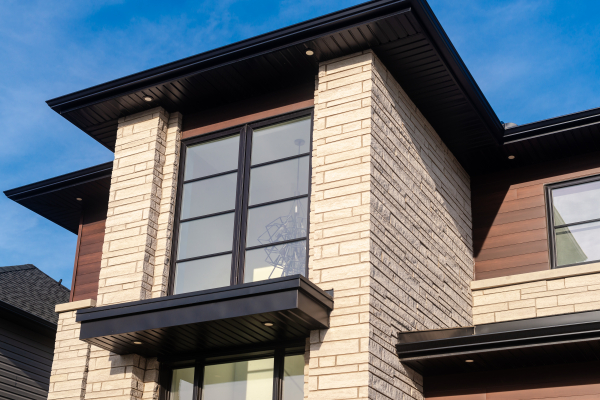Designs by Santy :: Modern Pilaster Home Front exterior flat roof entry with geometric window pattern and stone pilasters