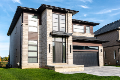 Designs by Santy :: Modern Pilaster Home Front exterior with modern pilasters, flat roof entry and vertical sconces